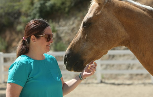 Paula Harold has a moment with Heidi, a horse she used in a horse therapy program through Equus Medendi Equine Assisted Therapy in Redlands on Wednesday, May 24, 2017. Paula is a survivor from the Dec. 2, 2015 terrorist attack in San Bernardino and is now dealing with PTSD. She has completed 12 sessions of the horse therapy program to help her deal with the issues. (Stan Lim, The Press-Enterprise/SCNG)