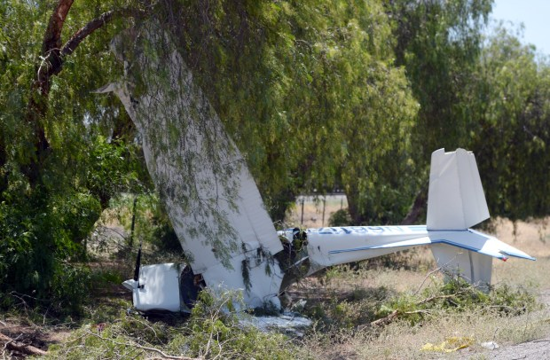 A small plane crashed near the Hargrave Street onramp on Friday, June 2, 2017 in Banning, Ca. Authorities said two people were conscious when extracted from the plane and transported to Desert Regional Hospital. The cause of the crash is under investigation. (Micah Escamilla, Redlands Daily Facts/SCNG)