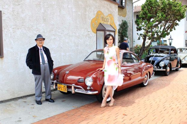Anh-Phuong Le and his granddaughter Vanna Nguyen pose with a classic Karmann Ghia at the VW d'Elegance car show at the Old World in Huntington Beach. COURTESY BRIAN STANLEY