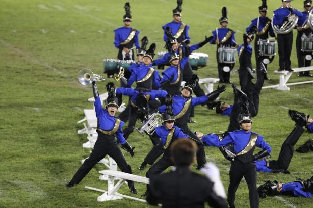 Playing French horn and hamming it up with the Royal Regiment has helped Melanie Chambraud, left, assimilate and thrive at Fountain Valley High. PHOTO COURTESY MELANIE CHAMBRAUD
