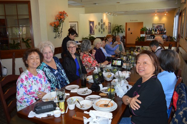 A group of the Our Neck of the Woods women get together for lunch at Olive Garden on May 8, talking and laughing about each other's families and pets. (Photo by Emily Rasmussen, contributing photographer)