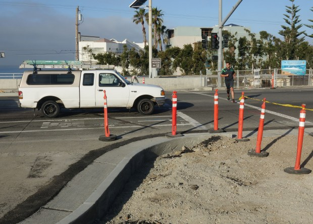 A jogger crosses El Camino Real at Camino Capistrano where the city of San Clemente has built a curb extension to shorten the crossing distance and shorten the red-light signal phase. (Photo by Fred Swegles, Orange County Register/SCNG)
