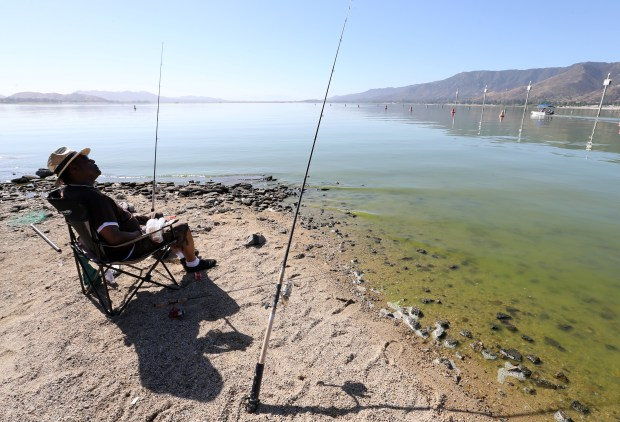 Fisherman Fred Bocye, 62, from Hemet checks his lines at Lake Elsinore in Lake Elsinore Wednesday, June 14, 2017. FRANK BELLINO, THE PRESS-ENTERPRISE/SCNG