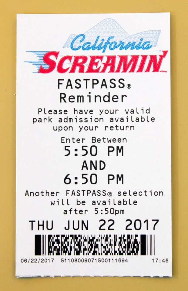 Under the new system, when visitors to the Disneyland Resort use their admission ticket or annual pass to one of its theme parks to obtain a Fastpass, they get a slip that is a reminder of their appointed ride time. But this paper is not what is scanned, it is just a reminder. The Fastpass is now tied to the admission ticket or annual pass. The slip also states what time the visitor can obtain another Fastpass. (Photo by Mark Eades, Orange County Register/SCNG)