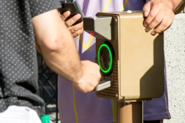 """The green light means the Fastpass time tied to the admission ticket is valid and the rider may go on the ride and skip the longer """"stand-by"""" line. This Fastpass scanner is for the Matterhorn Bobsleds. (Photo by Mark Eades, Orange County Register/SCNG)"""