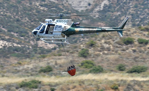 An Orange County Sheriff helicopter drops water near Irvine Lake during their annual CalFire certification in Silverado, California, on Wednesday, June 21, 2017. (Photo by Jeff Gritchen, Orange County Register/SCNG)
