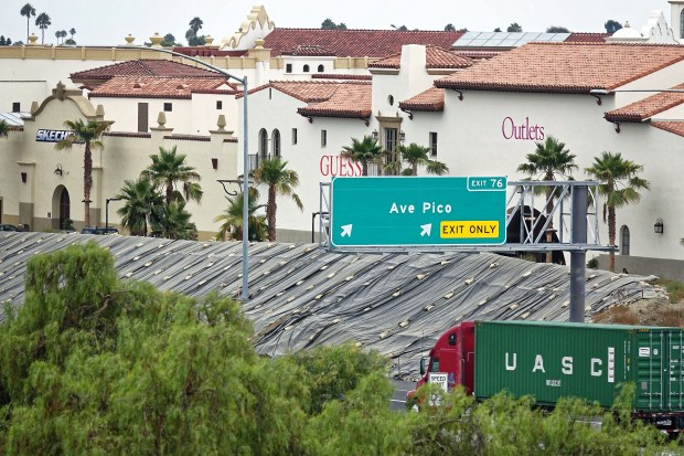 Skechers and GUESS are among 18 temporary banner signs that replaced blank walls in August 2016 at the Outlets at San Clemente. City says only six will be allowed. (File photo by Fred Swegles, Orange County Register/SCNG)
