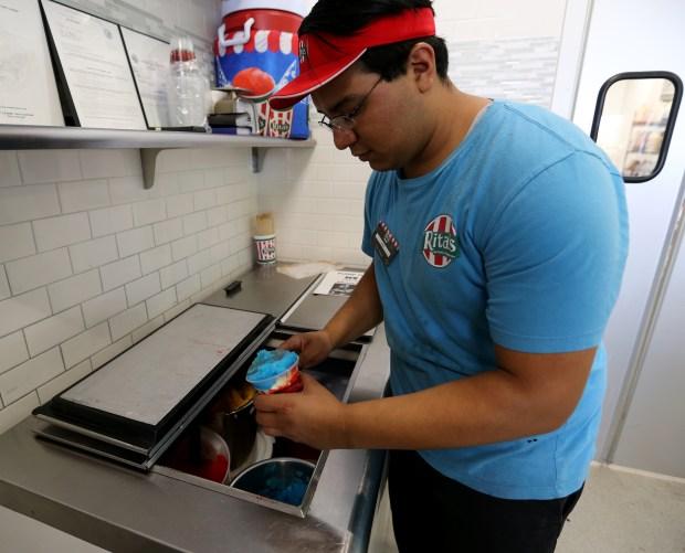 Rita's Jose Arauza makes their 4th of July's Gelati 5 layers frozen custard at Rita's in Murrieta on Thursday, June 29. FRANK BELLINO, THE PRESS-ENTERPRISE/SCNG