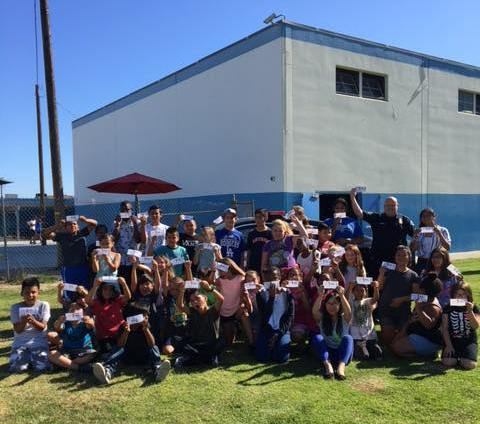 Buena Park police officers recently swung by the city's Boys and Girls Club to hand out tickets for good behavior. (Photo courtesy of Buena Park Police Department)