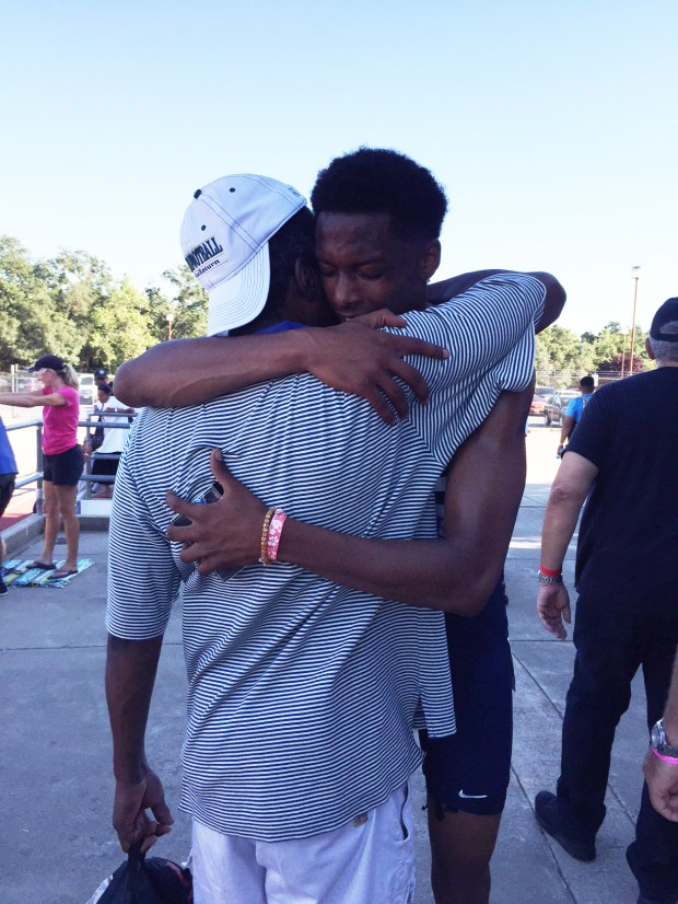 Outgoing Fullerton College student Justin Walker is embraced by his father, Joseph, after capturing the 110-meter hurdles state championship in a school-record 13.97 seconds. (Photo courtesy of Fullerton College)
