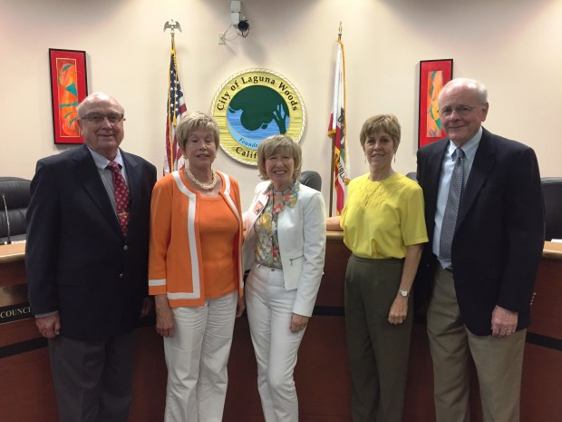 """Newly appointed Councilman William """"Joe"""" Rainey stands with council members after his appointment to Laguna Woods City Council on Wednesday, June 28. From left: Rainey, Mayor Pro Tem Carol Moore, Mayor Shari Horne, Cynthia Conners and Noel Hatch. (Photo by Emily Rasmussen, contributing photographer)"""
