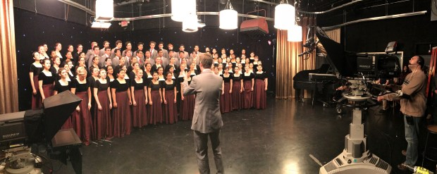 Justin Miller directs the Mater Dei High School choir for a taped performance at Catholic TV in Boston in March 2017. (Photo courtesy of Mater Dei High School)