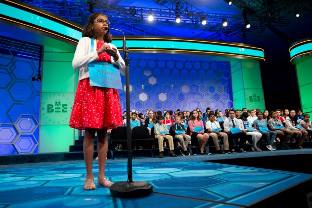 Aisha Randhawa, 10, of Corona, Calif., competes during the preliminaries of the 2016 National Spelling Bee, in National Harbor, Md., Wednesday, May 25, 2016. (AP Photo/Jacquelyn Martin) ORG XMIT: MDJM113 ORG XMIT: RIV1605250700522688