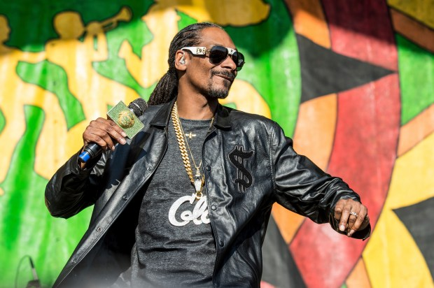 Long Beach native Snoop Dogg comes home Aug. 7 to headline the Summertime in The LBC concert at the Queen Mary. (Photo by Amy Harris/Invision/AP)