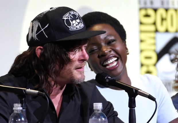 "Norman Reedus, left, and Danai Gurira attend ""The Walking Dead"" panel on day 2 of Comic-Con International on Friday, July 22, 2016, in San Diego. (Photo by Chris Pizzello/Invision/AP)"