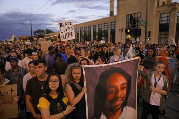 Supporters of Philando Castile hold a portrait of Castile as they march along University Avenue in St. Paul, Minn., leaving a vigil at the state Capitol on Friday, June 16, 2017. The vigil was held after St. Anthony police Officer Jeronimo Yanez was cleared of all charges in the fatal shooting last year of Castile. (Anthony Souffle/Star Tribune via AP) ORG XMIT: MNMIT345