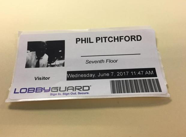 Riverside city spokesman Phil Pitchford created this example of new visitors' badges that are required for increased security at City Hall.