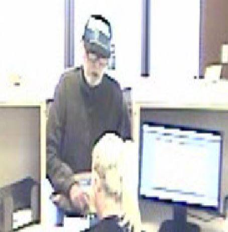 Police say they are looking for a man in his 50s-60s who left a Corona bank after leaving with an envelope full of cash he scored in a robbery.(Courtesy of Corona Police Department)