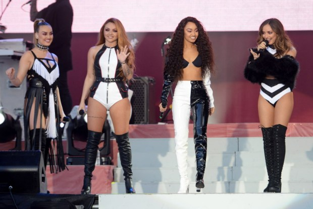 In this Sunday, June 4, handout photo provided by Dave Hogan for One Love Manchester, singers Perrie Edwards, from left, Jesy Nelson, Leigh-Anne Pinnock and Jade Thirlwall from the bad Little Mix perform at the One Love Manchester tribute concert in Manchester, north western England. One Love Manchester is raising money for those affected by the bombing at the end of Ariana Grande's concert in Manchester on May 22. (Dave Hogan via AP)