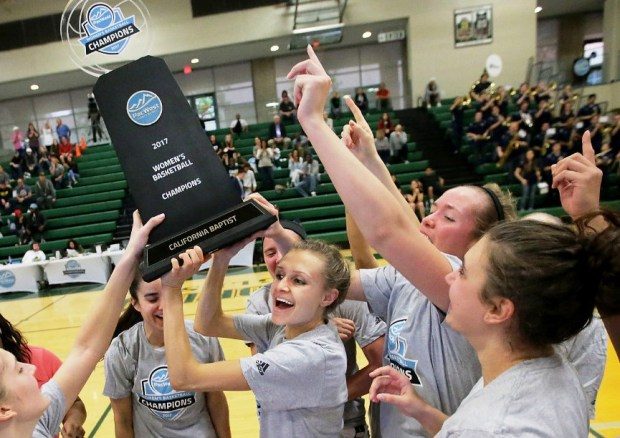 Cal Baptist player celebrate after winning the program's first PacWest tournament title.