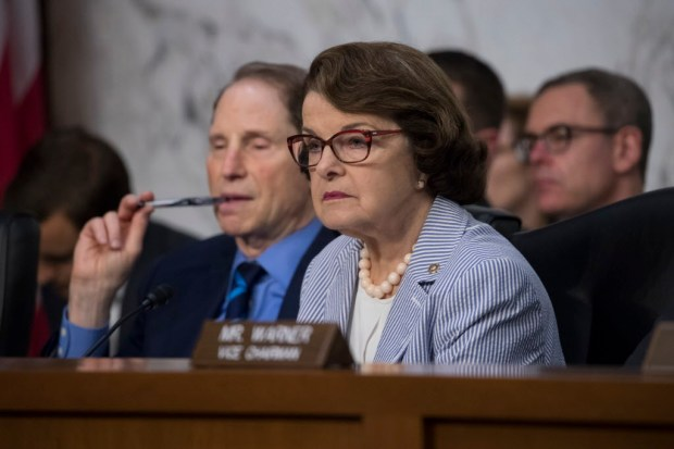 Sen. Dianne Feinstein, D-Calif., right, joined at left by Sen. Ron Wyden, D-Ore., listen as formerFBI director James Comey testifies before the Senate Select Committee on Intelligence, on Capitol Hill in Washington, Thursday, June 8. (AP Photo/J. Scott Applewhite)