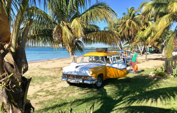 A vintage taxi loads up tourists for the trip back to Havana from Caleton, Playa Larga on the Bay of Pigs.