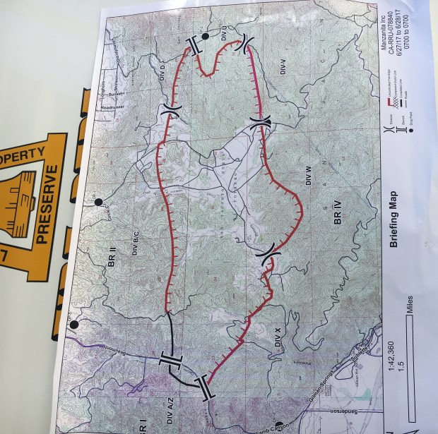 A map posted at firefighters' command post a Noble Creek Park in Cherry Valley showed the perimeter of the Manzanita fire as of Tuesday morning, June 27, 2017. The part of the border that's black shows where the fire is contained; the red border is uncontained fire. (Photo by Ali Tadayon, The Press-Enterprise/SCNG)