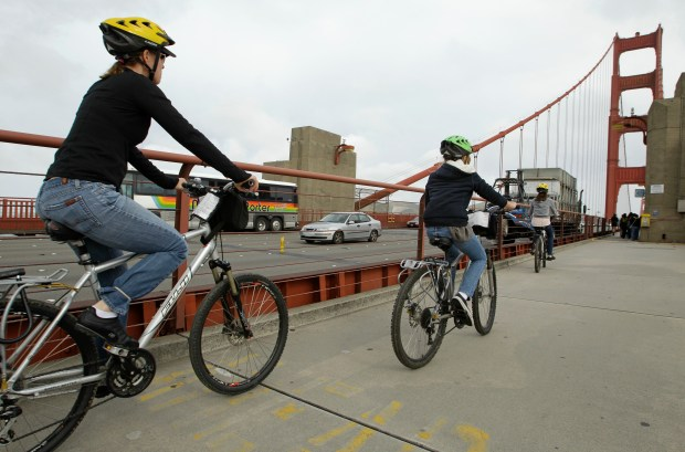 ORG XMIT: FX108 In this April, 22, 2011 photo, a group of bicyclists ride across the Golden Gate Bridge in San Francisco. A plan to put the brakes on bicyclists riding across the bridge has commuters and cycling enthusiasts crying foul. Officials who oversee San Francisco's signature landmark first said cyclists should prevent accidents by slowing to 5 mph near the Golden Gate's steel towers, or face a $100 ticket. Now, after bicyclists' public protests, the speed limits are on hold while authorities and riders debate the proposal. (AP Photo/Eric Risberg)