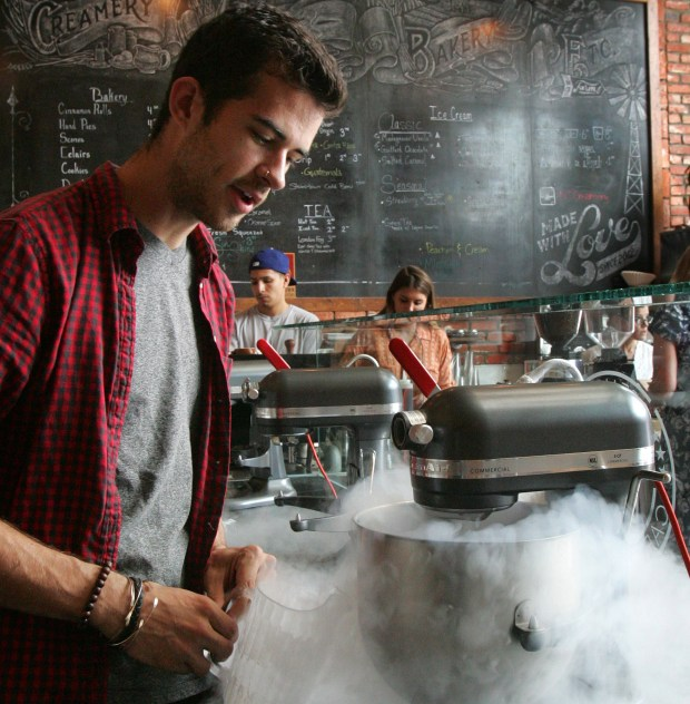 Michael Mascaro, co-owner of N7 Creamery in Rancho Cucamonga, applies liquid nitrogen to a mixing bowl to freeze an ice cream concoction, on Saturday, July 18, 2015.