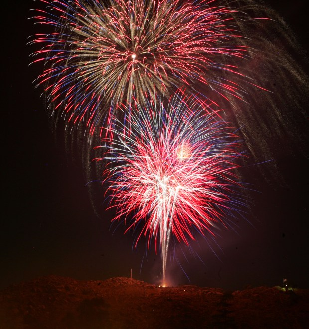 Fireworks explode over Mr. Rubidoux as seen during the Front Row Fireworks event at Evergreen Memorial Historic Cemetery in downtown Riverside., on Saturday, July 4, 2015.