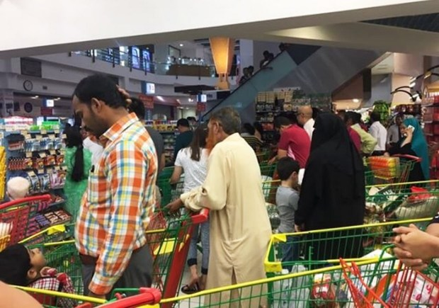 People are seen buying essential food staples at a supermarket in Doha, Qatar, Monday, June 5, 2017. Four Arab nations have cut diplomatic ties to Qatar, further deepening a rift between Gulf Arab nations over that country's support for Islamist groups. Bahrain, Egypt, Saudi Arabia and the United Arab Emirates all said they would withdraw their diplomatic staff from Qatar, a gas-rich nation that will host the 2022 FIFA World Cup. (@shalome05 via AP) ORG XMIT: CAI102
