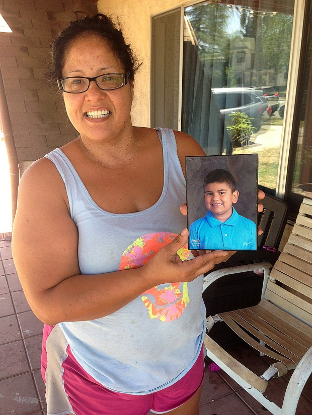 Kathleen Castro poses on June 14, 2017, with a photo of her nephew,Jonah Reyes, 8, who was hit by a car in the 1100 block of North La Cadena Drive in Colton. (Photo by Brian Rokos, The Press-Enterprise/SCNG)