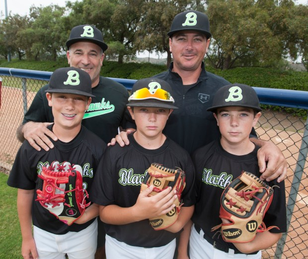 Craig Strenger, back left, and CJ Ankrum, back right, are Rancho Santa Margarita Little League and travel ball coaches with their sons Garrett Strenger, 12, Blake Ankrum, 10, and Tyler Ankrum, 13in Rancho Santa Margarita on Wednesday, June 7, 2017. (Photo by Sam Gangwer, Orange County Register/SCNG)