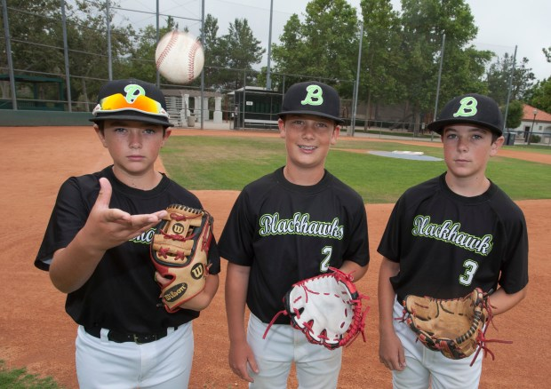 Blake Ankrum, 10, left, Garrett Strenger, 12, center, and Tyler Ankrum, 13, right, are coached by their fathers in Rancho Santa Margarita Little League and travel ball in Rancho Santa Margarita Wednesday, June 7, 2017. (Photo by Sam Gangwer, Orange County Register/SCNG)
