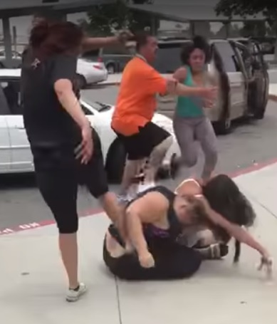 Two women and two girls fight outside Tahquitz High School in Hemet on Wednesday, May 31, 2017. Hemet police said they are recommending misdemeanor battery charges be filed against all four of them. (Image via YouTube)