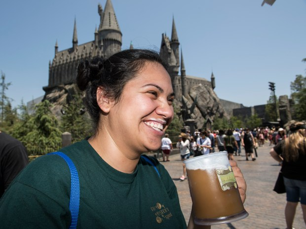 Joselin Rodriguez, 23, of San Francisco, is all smiles after drinking a frozen Butterbeer at The Wizarding World of Harry Potter at Universal Studios Hollywood in Universal City on Friday, June 30, 2017. (Photo by Ed Crisostomo, Los Angeles Daily News/SCNG)