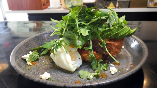 Avocado toast at Outpost Kitchen in Costa Mesa is topped with peppedew pesto, housemade ricotta, harissa and arugula. (Photo by Brad A. Johnson, Orange County Register/SCNG)