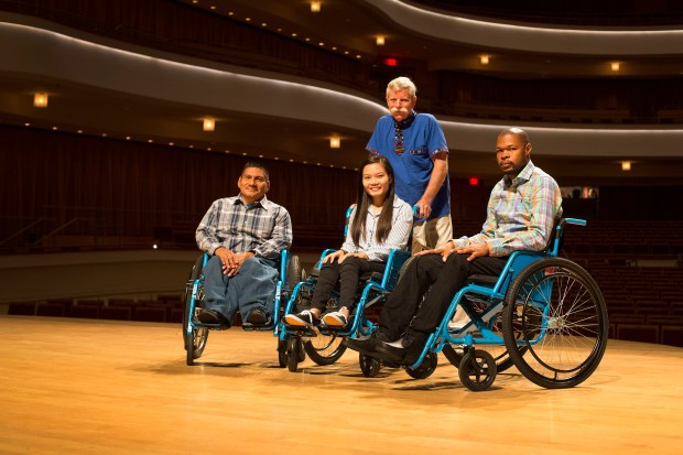 Founder and president of Free Wheelchair Mission, Don Schoendorfer, top, is shown with, from left, Gregory Grizzle, Vo Thi Thuy Hien and Amilcar Hernandez at the Segerstrom Concert Hall. (Photo by Drew A. Kelley, Contributing Photographer)