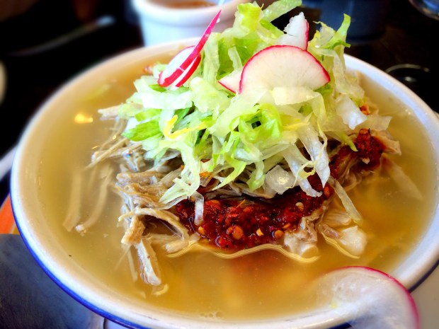 Potzol den Cano in Santa Ana serves white pozole, which the customer can transform with a choice of green or red salsa. (Photo by Brad A. Johnson, Orange County Register/SCNG)