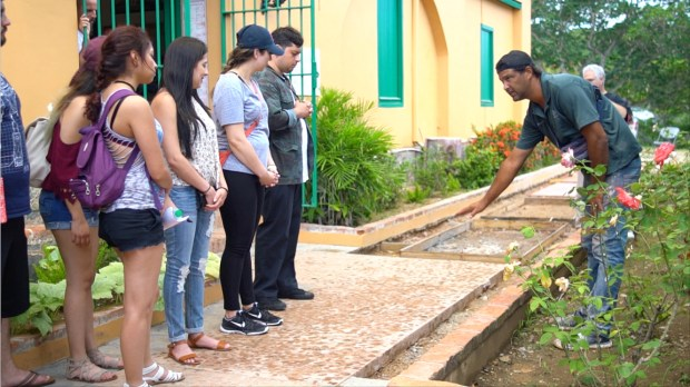 Students from Cal State Fullerton learn about the restoration project for the Museo Fuerte Conde de Mirasol, a building that hosts a museum, an archive and a radio station in Vieques, Puerto Rico. (Photo courtesy of Alicia Afshar)