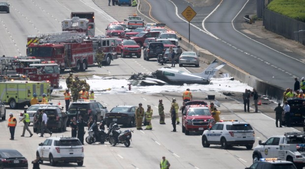 Emergency crews work the scene of a small plane crash on the 405 Freeway next to John Wayne Airport Friday morning in Costa Mesa, CA on Friday, June 30, 2017. (Photo by Kevin Sullivan, Orange County Register/SCNG)