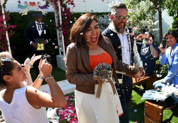 Melissa and Esteban Martinez, of San Diego, walk down the aisle after being married by actor Orlando Jones at the SYFY Geek Love Chapel during Comic-Con International in San Diego, CA., Thursday, July 20, 2017. (Staff photo by Jennifer Cappuccio Maher/Southern California News Group)