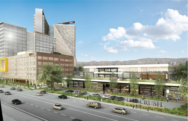 An artist's rendering shows a new look for the former Orange County Register headquarters in Santa Ana. The two-story office building on Grand Avenue would be converted into 21,000 square feet of shops and restaurants, one of three retail buildings on the 20-acre newspaper site. A small television station is now the property's sole tenant. (Photo courtesy of Caribou Industries)