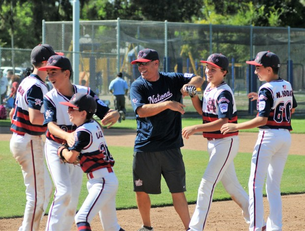 The Santa Margarita National Little League Majors Division All-Stars celebrate after their hard-fought 9-8, extra-inning victory Eastlakein the Southern California Divisional Little League tournament Sunday, July 23, in Long Beach. Photo courtesy of Lou Ponsi