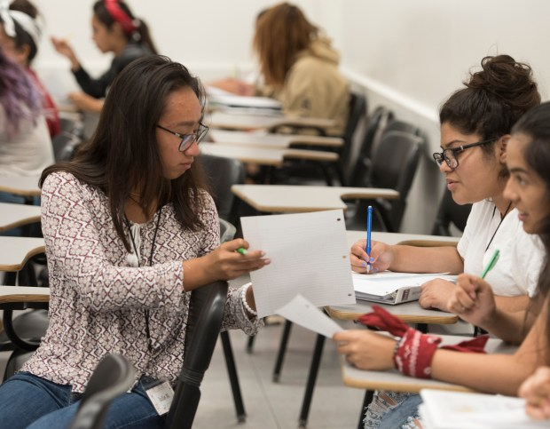Jullie Nguyen, left, and Adileny Gonzalez, right, check their work during Project MISS, a summer program now in its 28th year that has helped more than 1,500 teenage girls from underrepresented ethnic groups bolster their algebra, geometry and precalculus skills in Fullerton on Thursday, July 20. (Photo by Sam Gangwer, Orange County Register/SCNG)