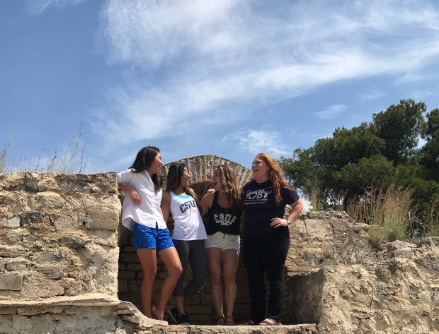 Cal State Fullerton students, from left, Felicia Medalla, Teresa Wong, Clair Cunningham and Samantha Richards climb some ancient ruins in Isthmia, Greece. (Photo courtesy of Samantha Richards)