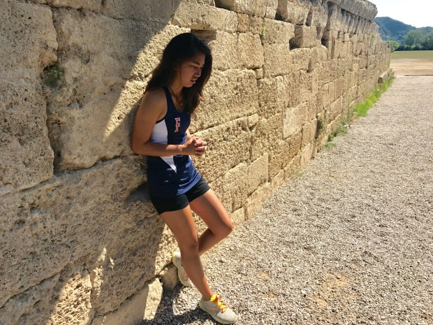 Cal State Fullerton student Felicia Medalla stands at the entrance to the stadium in Nemea where the original Olympic Games took place. She thought about what the ancient athletes might have done before they competed. (Photo courtesy of Felicia Medalla)