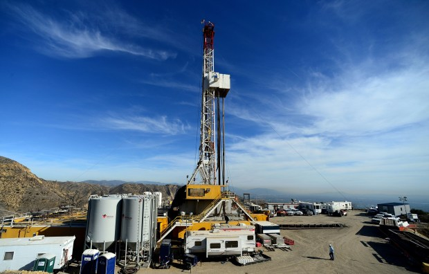 In this Dec. 9, 2015, file photo, crews work on stopping a gas leak at a relief well at the Aliso Canyon facility above the Porter Ranch area of Los Angeles.