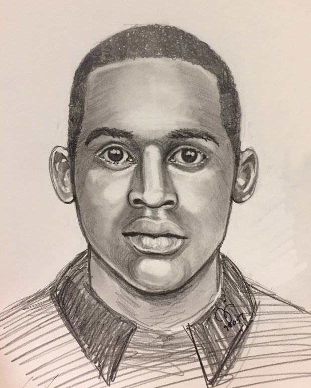 """The Irvine Police Department has released a sketch of the suspect in an armed robbery that occurred Saturday night at Northwood Place apartments. The suspect is described as a black male in his late 20s to early 30s, approximately 6'0"""" to 6'2"""" and weighing 175 pounds. He has short black hair and dark eyes."""