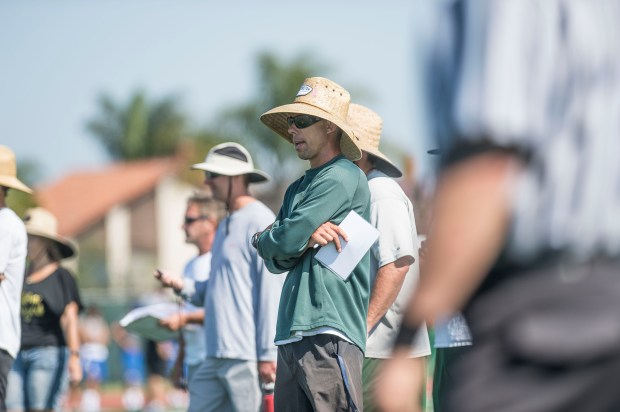 Edison head coach Jeff Grady watches action on the field during the Battle at the Beach seven on seven football tournament at Edison High School in Huntington Beach on Saturday, July 8, 2017. (Photo by Matt Masin, Orange County Register, SCNG)